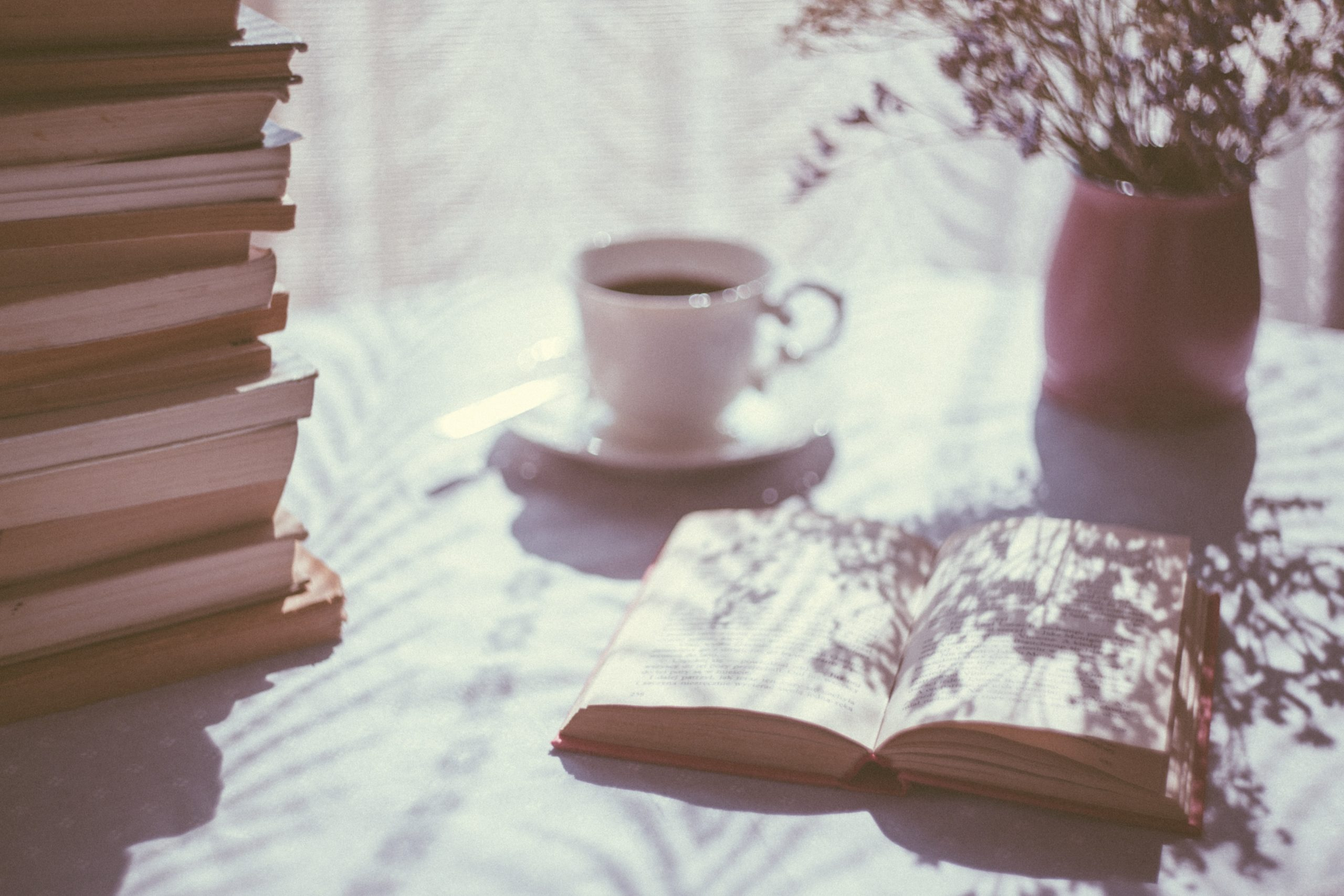 cup of coffee and book on table