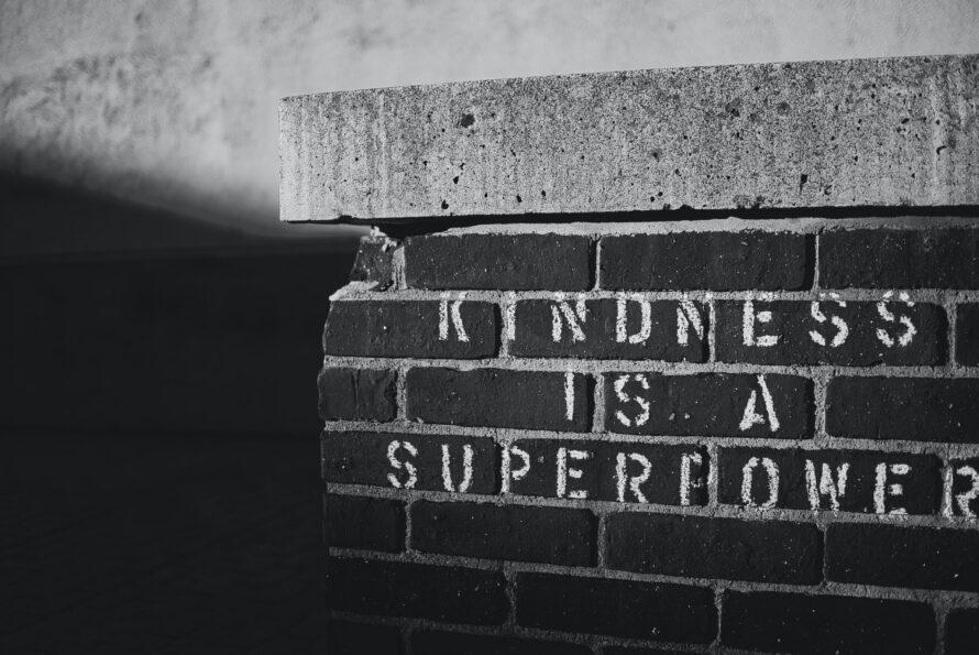 Kindness is a Super Power written on a brick wall